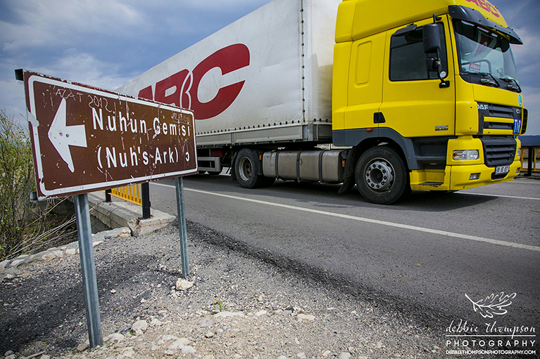 An Iranian truck passing the sign for Noah's Ark